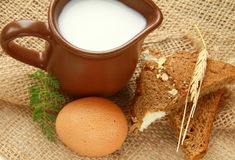 Glass jug with milk and  eggs Stock Photos