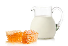 Glass jug with milk and honey Royalty Free Stock Photography