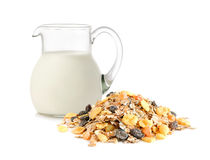 Glass jug with milk and muesli Royalty Free Stock Photography