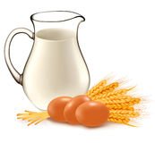 Glass jug with milk, wheat seeds and eggs. Royalty Free Stock Photo