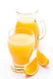 Glass and jug of orange juice and fresh orange slices Royalty Free Stock Photo
