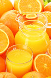 Glass and jug of orange juice and fruits Stock Photography