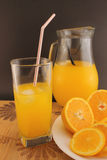 Glass and jug of orange soda Stock Image