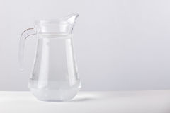 Glass jug with water isolated on white background Stock Photography