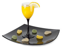 A glass of juice. On a plate Stock Images