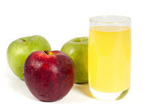 Glass of juice and apples Royalty Free Stock Photo