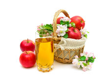A glass of juice and a basket of apples on white background Royalty Free Stock Image