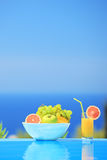 Glass of juice and bowl of different fruits  Royalty Free Stock Image