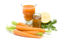 Glass of juice, carrots, honey and lemon Royalty Free Stock Images
