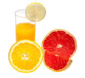 Glass of juice and citrus Royalty Free Stock Photo