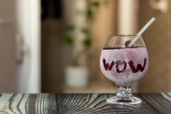 A glass of juice covered in icy sweat is prepared to beat the heat stock image