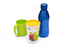 Glass of Juice, Cup & Water Bottle on White Royalty Free Stock Photo