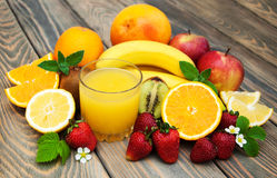 Glass with juice and fresh fruits Royalty Free Stock Image