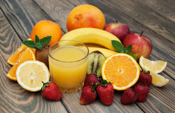 Glass with juice and fresh fruits Royalty Free Stock Photo