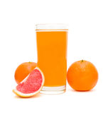 Glass of juice and fruit on a white background Stock Image
