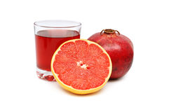 Glass with juice and fruits Royalty Free Stock Photos