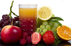 Glass of juice and fruits Stock Images