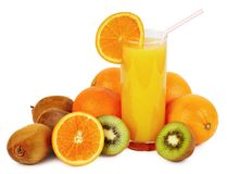Glass of juice and fruits. Glass of juice with straw and tropical fruits isolated on white Royalty Free Stock Image