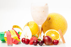 Glass of juice and fruits Royalty Free Stock Images