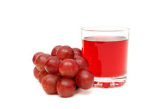 Glass with juice and grapes Royalty Free Stock Photo