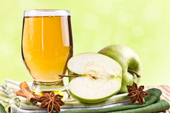Glass of juice and green apple Stock Photo