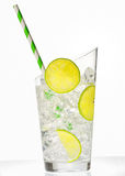 Glass with juice and ice cubes Royalty Free Stock Photos