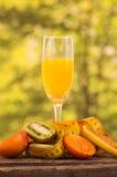 Glass of juice with  kiwi, tree tomato and banana Stock Photography
