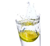 Glass with juice and lemon Stock Images