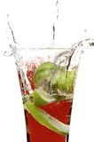 Glass with juice and lime Stock Photography