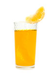 Glass of juice with the lobule of orange Stock Photos