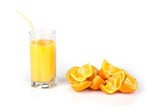 Glass of juice and orange peel Royalty Free Stock Photo