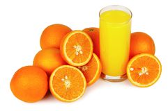 Glass of juice and oranges Stock Photo