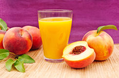 Glass of juice with peaches Royalty Free Stock Image