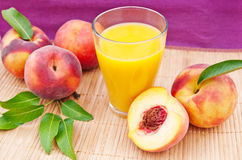 Glass of juice with peaches Royalty Free Stock Photo