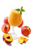 Glass of juice from peaches with mint Stock Photo