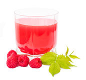 Glass with juice and placer raspberries Royalty Free Stock Image