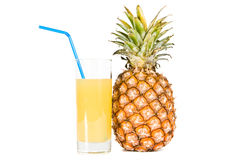 The glass of  juice and ripe pineapple Stock Photo