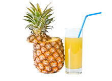 The glass of  juice and ripe pineapple Stock Images