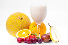 Glass of juice and several fruits Stock Photography