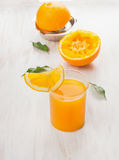 Glass of  juice, squeezed orange and citrus press Stock Images