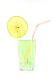 Glass of juice with a straw and slice apple Stock Images