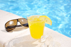 Glass of juice and sun glasses Royalty Free Stock Photography