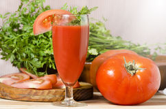Glass with juice of tomato Stock Photography