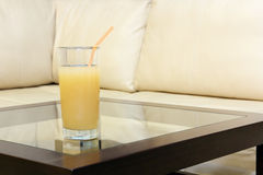 Glass juice on transparent table. Royalty Free Stock Photos