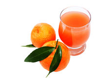 Glass of juice and two mandarins Stock Photography