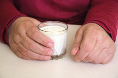 A glass of kefir in the hands Stock Photo