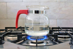 Glass kettle Stock Images