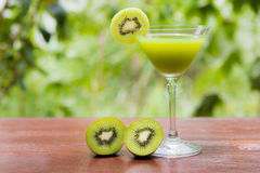 Glass of kiwi juice Stock Photos