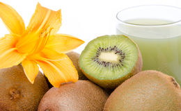 Glass of kiwi juice, fresh kiwis and a flower. Composition with a glass of kiwi juice, fresh kiwis and a flower royalty free stock image