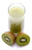 Glass of kiwi juice and some fresh kiwis. Isolated on white Royalty Free Stock Image